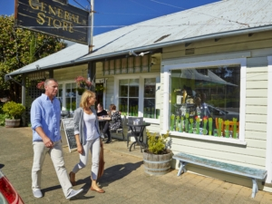 A couple enjoying shopping in historic Berrima village - Sip n Savour Lite day tour from Sydney. Photo courtesy Destination NSW